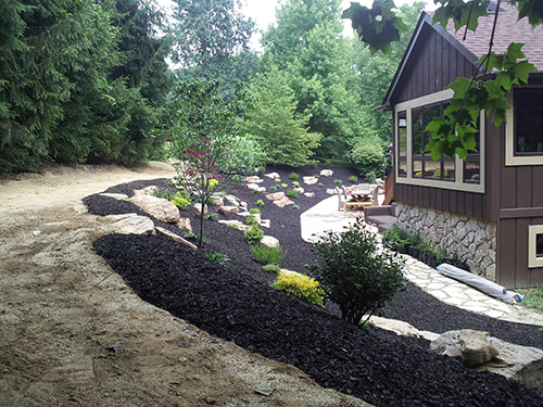 Black Mulch Rockscape by JG Landscape & Design